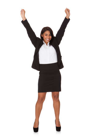arms raised: Portrait Of Successful Businesswoman. Isolated on white