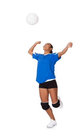 female volleyball: Surprised Young Girl Playing The Volleyball. Isolated On White Stock Photo