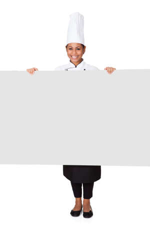 Female Cook Standing Behind The Placard. Isolated On White photo