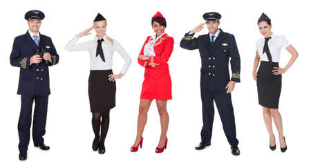 an attendant: Flight crew members, pilots, stewardesses. Isolated on white Stock Photo