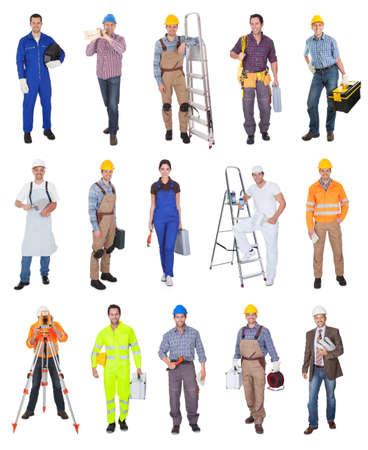 Los trabajadores industriales de la construcción. Aislado sobre fondo blanco Foto de archivo