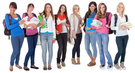 Large group of female students. Isolated on white photo