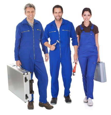 service technician: Group of automechanic. Isolated on white background Stock Photo