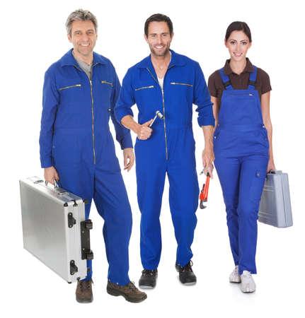 car maintenance: Group of automechanic. Isolated on white background Stock Photo