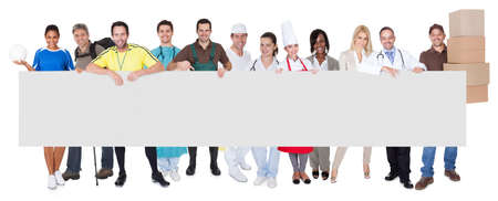 professions: Group of diverse professionals presenting empty banner. Isolated on white