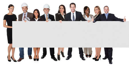 Group of business people presenting empty banner. Isolated on white Stock Photo - 18065417