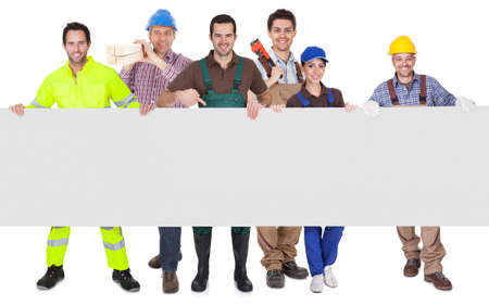 Group of workers presenting empty banner. Isolated on white Stock Photo