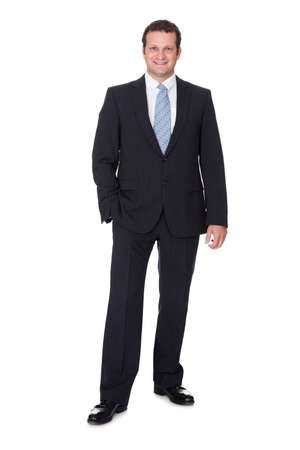 standing man: Portrait of successful businessman. Isolated on white background
