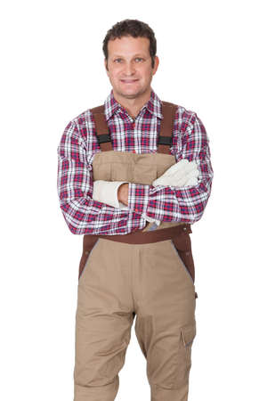 folded hands: Portrait of construction worker. Isolated on white background Stock Photo