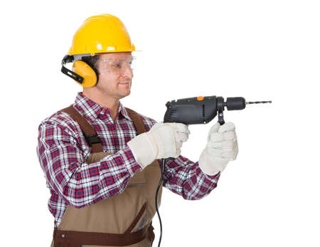 electric drill: Portrait of construction worker. Isolated on white background Stock Photo