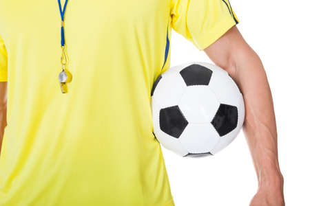 whistles: Soccer judge standing with ball. Isolated on white background Stock Photo