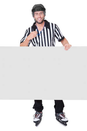 Portrait of hockey judge presenting empty banner. Isolated on white photo