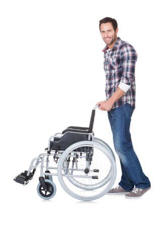 Portrait of young man with wheelchair. Isolated on white photo