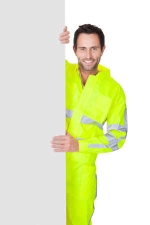Happy worker wearing safety jacket. Isolated on white photo