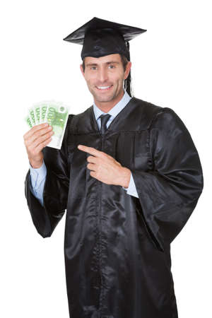 Portrait of happy graduate student with cash. Isolated on white photo