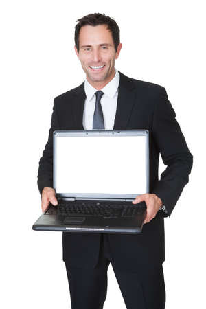 laptop stand: Happy middle aged businessman with laptop. Isolated on white Stock Photo