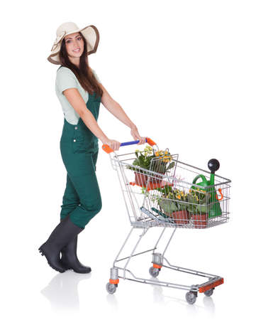 Smiling Attractive Woman Holding Shopping Cart. Isolated On White Stock Photo