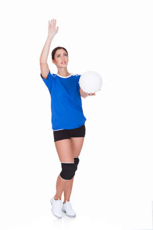 Happy Sporty Woman Holding Ball  And Gesturing. Isolated On White photo