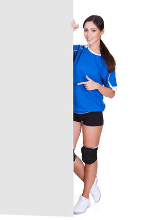 Sporty Woman Holding Blank Placard. Isolated On White Stock Photo - 18065115