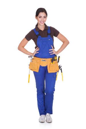 mecanico: Trabajador de la construcci�n femenina con Toolbelt. Aislado En Blanco