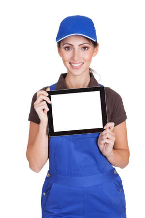 Sonriendo explotaci�n femenina Plumber Tablet Digital. Aislado En Blanco photo