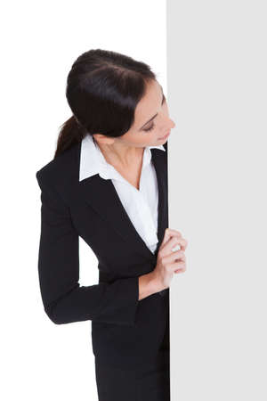 Happy Smiling Young Business Woman Holding Blank Placard. Isolated On White Stock Photo - 18065429