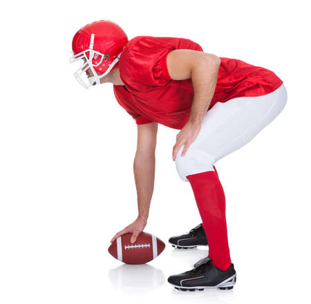 touch down: Portrait of American Football player. Isolated on white Stock Photo