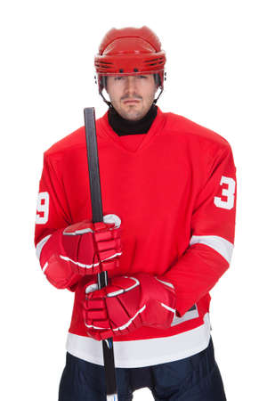 Portrait of professional hockey player. Isolated on white photo