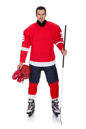 hockey sobre hielo: Profesional hockey jugador tras partido. Aislados en blanco