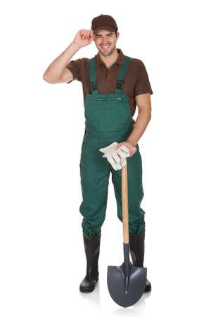 jardinero: Jardinero joven feliz en mono. Aislados en blanco Foto de archivo