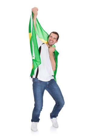 Portrait Of A Happy Man Holding An Brazilian Flag. Isolated on white photo