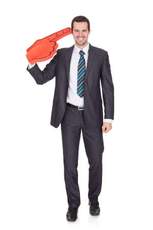 Portrait Of Excited Young Businessman. Isolated on white photo