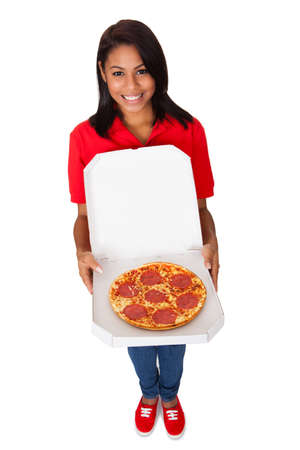 Young Woman With A Whole Pizza. Isolated On White photo
