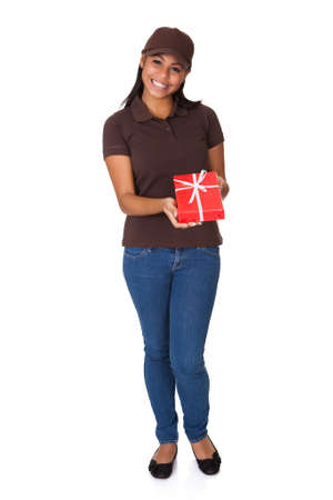 Young Woman Giving Gift Box. Isolated On White photo