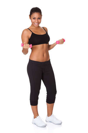 Happy Fitness Woman With Pink Dumbbells. Isolated On White photo