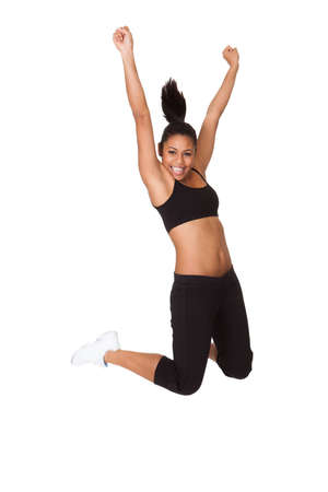 Portrait Of Excited Young Woman Jumping. Isolated On White