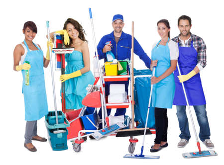 Group of professional cleaners. Isolated on white photo