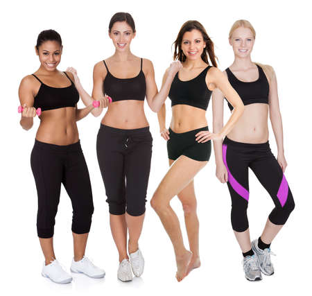 physical fitness: Group of fitness women. Isolated on white Stock Photo
