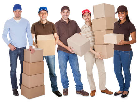 Group of delivery people with boxes. Isolated on white photo