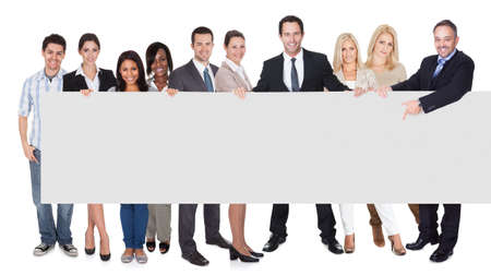 people: Group of business people presenting empty banner. Isolated on white