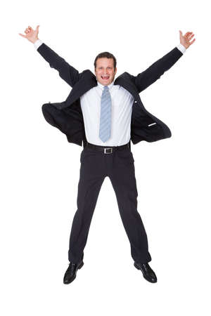 Portrait of excited businessman. Isolated on white background Stock Photo - 18209523