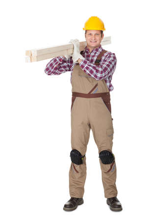 Carpenter with wooden planks. Isolated on white background photo