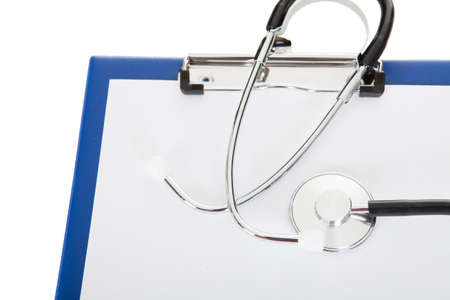 Stethoscope and clipboard. Isolated on white background photo
