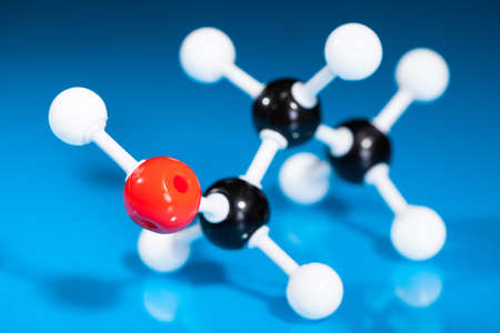 Model of molecular structure on blue reflective background photo