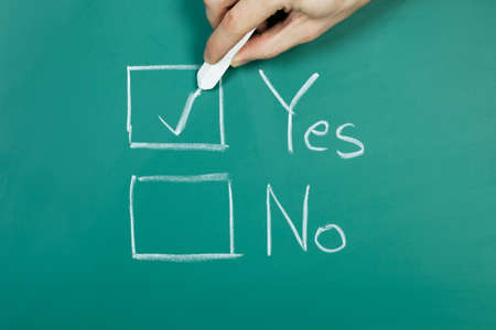 Hand holding chalk making a yes choice Stock Photo - 18178562
