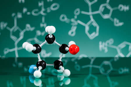 chemical formula: Model of molecular structure on green reflective background