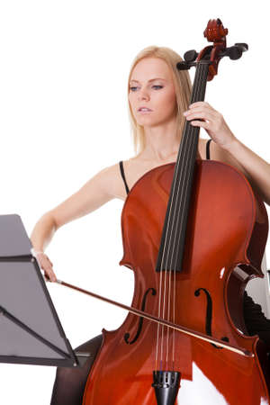 Beautiful young woman playing cello. Isolated on white Stock Photo - 18341909