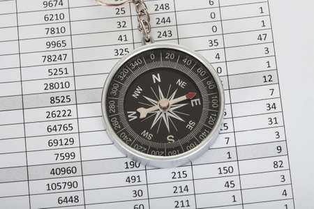 Close-up on compass on top of business data papers Stock Photo - 18315734