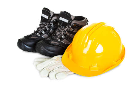 Pair of shoes, helmet and gloves. Isolated on white photo