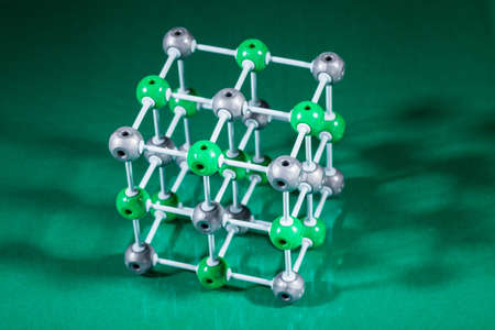 Model of molecular structure on green reflective background